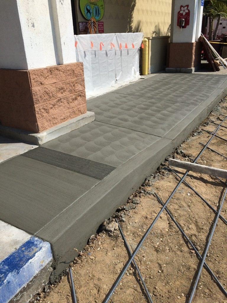 wet cement of new sidewalk
